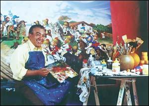 Mauricio de Sousa diante da pintura da Turma da Mônica e o Grito do Ipiranga